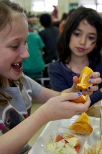young-school-girl-eating-at-school-725x482